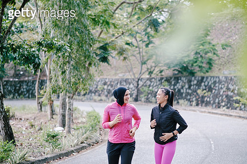 Beautiful Mother and Daughter Jogging Together at The Park - gettyimageskorea