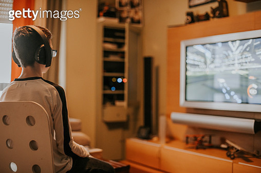 teenager boy Gaming game play video on tv or monito - gettyimageskorea