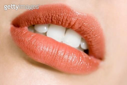 Wearing lipstick - gettyimageskorea