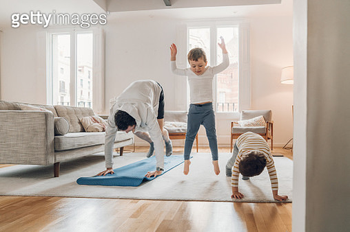 Father with children exercising at home - gettyimageskorea