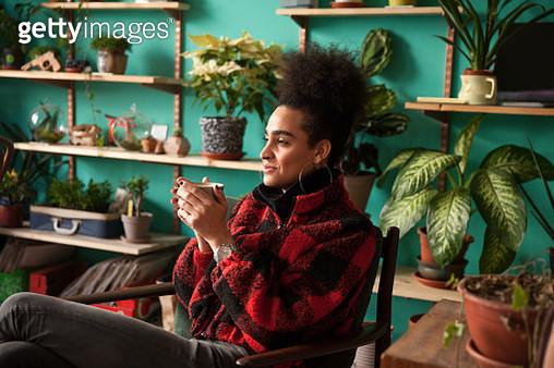 Trans woman on her coffee break - gettyimageskorea