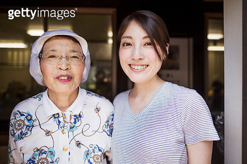 Two women at a noodle shop, a small unit with a fast food kitchen and unit producing Soba noodles - gettyimageskorea