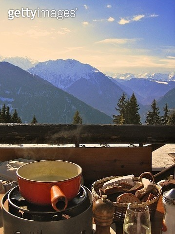 Cheese fondue on balcony with mountains in background, Switzerland - gettyimageskorea