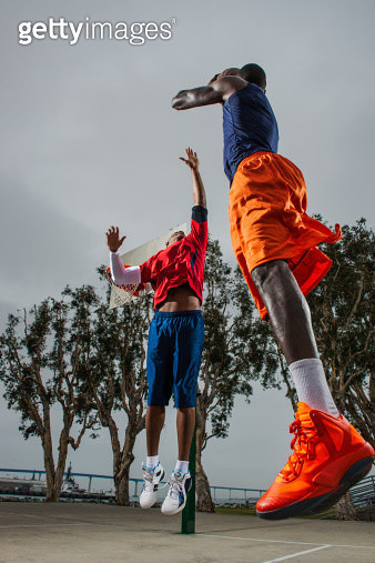 Young basketball players jumping to score - gettyimageskorea