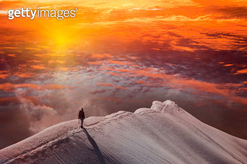 Person on mountain at sunset, Piz Palu, St Moritz, Canton Graubunden, Switzerland - gettyimageskorea