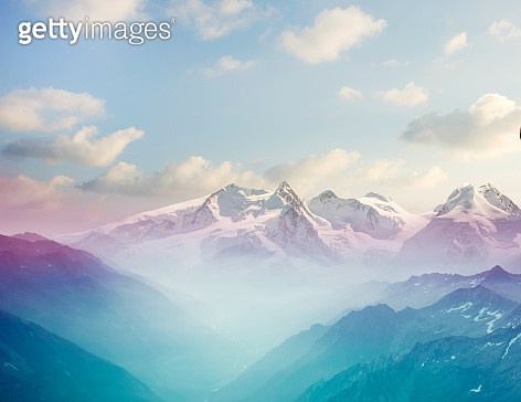 Morning mist in an alpine valley - gettyimageskorea