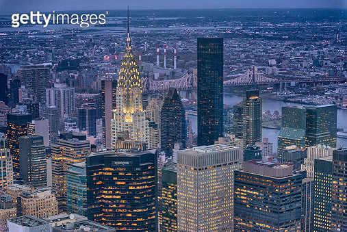 New york skyscraper and chrysler building at night - gettyimageskorea