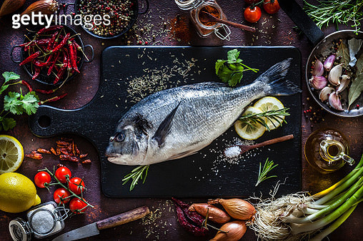 Sea bream and ingredients for seasoning and cooking fish - gettyimageskorea