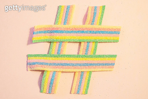 Creative picture of an internet hashtag made with Candy strips. - gettyimageskorea