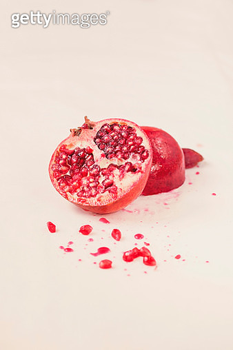 Close-up of pomegranate on white background - gettyimageskorea