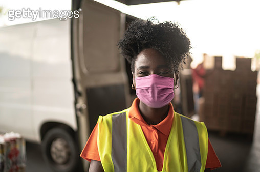 African young woman portrait at warehouse with face mask - gettyimageskorea