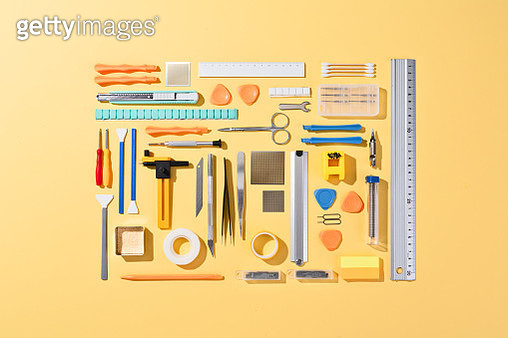 Collection of Various Tools on Yellow Colored Background. - gettyimageskorea