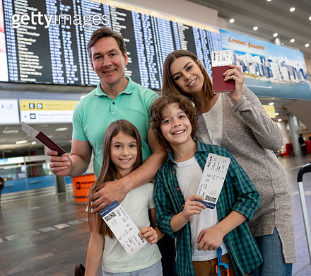Portrait of a family traveling and looking very happy at the airport - gettyimageskorea
