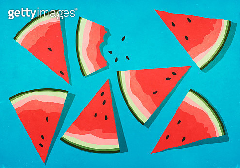 Vibrant watermelon slices on blue background - gettyimageskorea