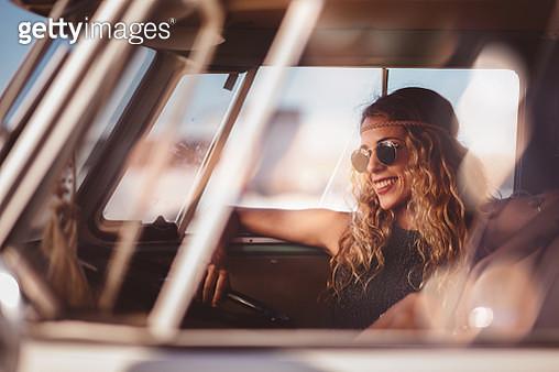 Blonde Hipster Girl Sitting in Interior of Retro Van - gettyimageskorea