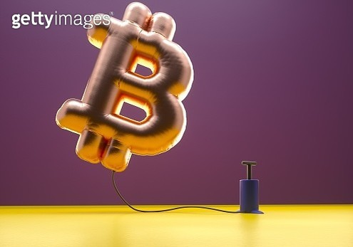 Bitcoin sign balloon inflating - gettyimageskorea