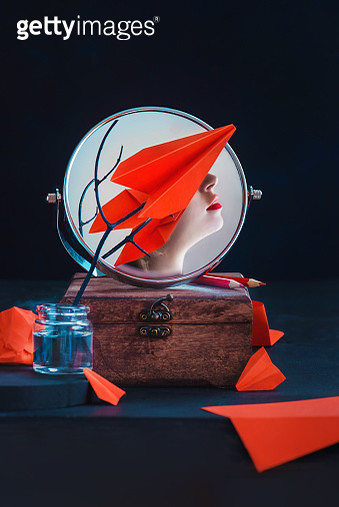 Conceptual portrait with red paper place covering eyes of young female artist with red lipstic - gettyimageskorea