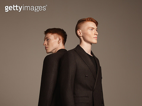 Studio portrait of twins - gettyimageskorea