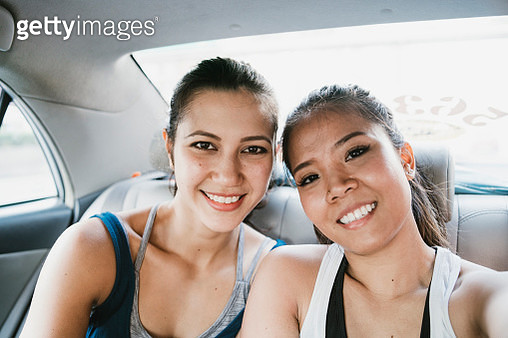 Young women taking a selfie together inside a car - gettyimageskorea