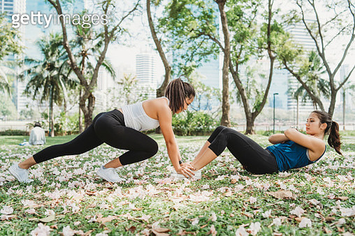 Young women training together at the park - gettyimageskorea