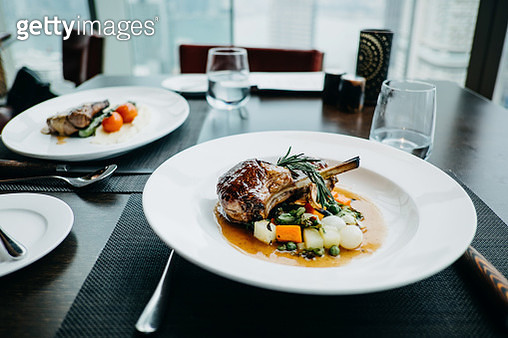 Delicate main course of braised lamb chop and steak freshly served on table in a restaurant - gettyimageskorea