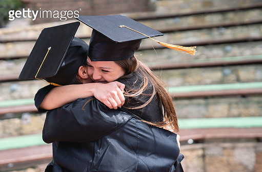 Happy students hugging and celebrating their graduation - gettyimageskorea