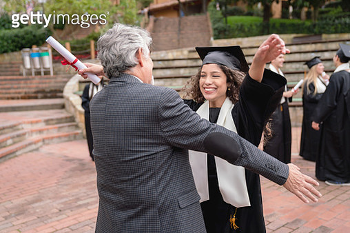Happy student hugging her father and celebrating her graduation - gettyimageskorea