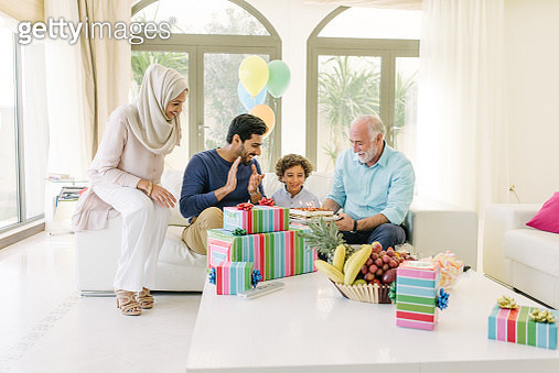 Three Genration Arabic family celebrating a childs birthday - gettyimageskorea