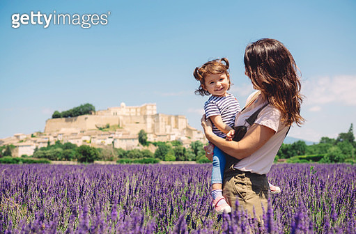 France, Grignan, portrait of happy baby girl together with her mother in lavender field - gettyimageskorea
