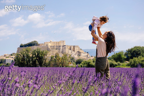 France, Grignan, mother and little daughter having fun together in lavender field - gettyimageskorea