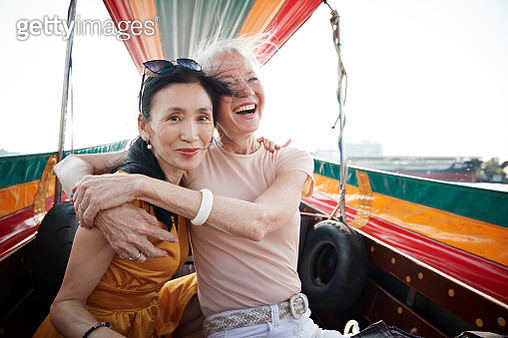 Portrait of woman sitting with friend in boat - gettyimageskorea