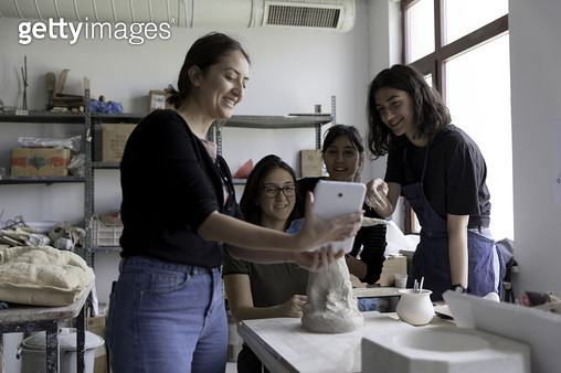 Young woman's using digital tablet, student's looking. - gettyimageskorea