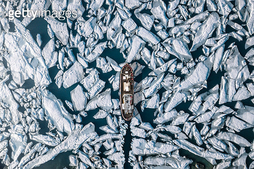 Aerial View Of Ship Amidst Glacier In Sea - gettyimageskorea