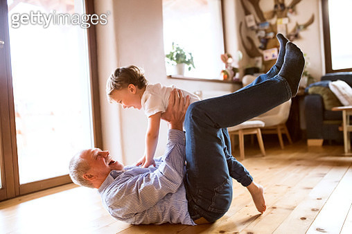 Grandfather and grandson having fun at home - gettyimageskorea