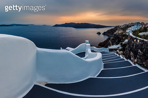 Staircase with dark stairs and white railing  lead ti the sea coast - gettyimageskorea