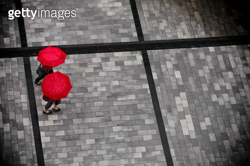 Red umbrellas on square from above - gettyimageskorea