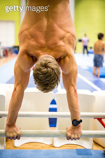 Male Gymnast Doing a Handstand on Parallel Bars, Rear View - gettyimageskorea