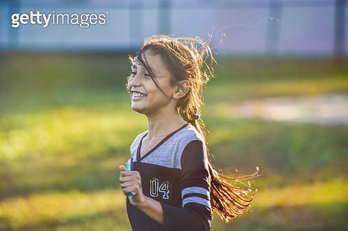 A girl running. - gettyimageskorea