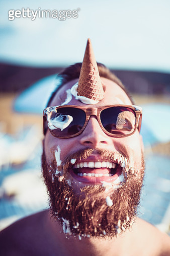 Handsome Bearded Male Playing With Ice Cream - gettyimageskorea