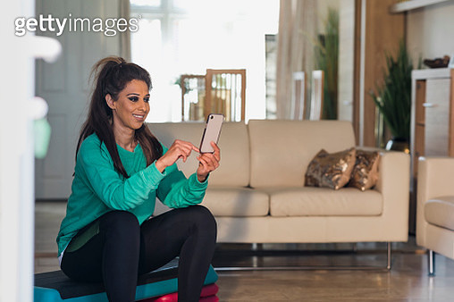 Checking her Fitness App - gettyimageskorea