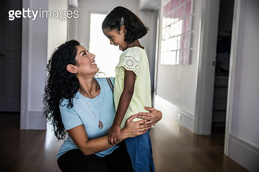 Daughter greeting mother after work - gettyimageskorea