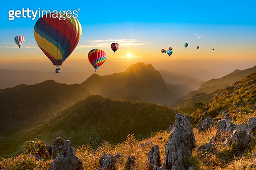 Colorful hot air balloons flying over mountain in Thailand. - gettyimageskorea