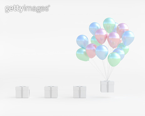 Close-Up Of Balloons And Gift Box Against White Background - gettyimageskorea