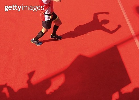 Low Section Of Happy Runner Crossing Finish Line - gettyimageskorea