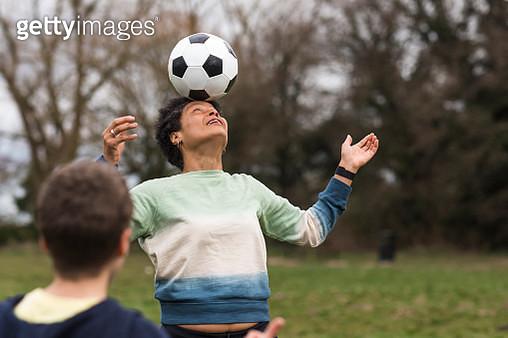Mature Woman Balancing a Ball on Her Head - gettyimageskorea
