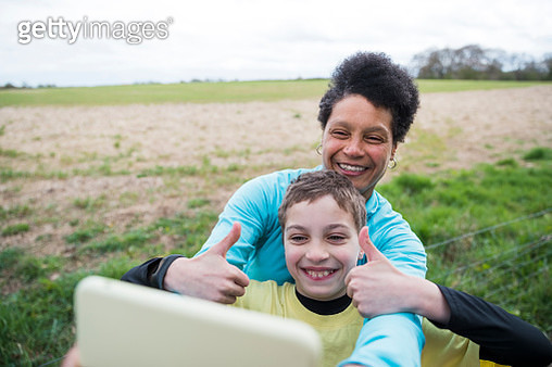 Mother and Son Taking a Selfie on a Run - gettyimageskorea