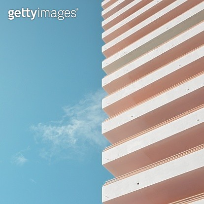 Minimal image with half side blue sky, other half white building. - gettyimageskorea