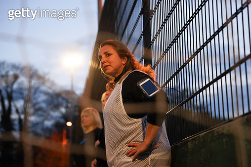 Women watches her team from the sidelines - gettyimageskorea