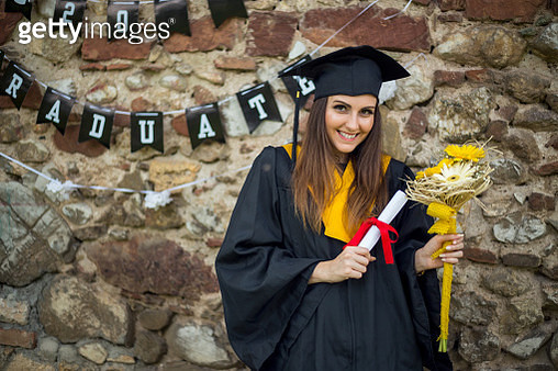 Happy woman on her graduation day . Education and people. - gettyimageskorea
