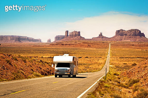 RV Camper Road Trip at Monument Valley Tribal Park Landscape - gettyimageskorea
